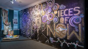 """""""Pieces of Now"""" mural at the entrance to the Greensboro History Museum exhibit"""